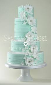 this cake looks beautiful mint stripe white flowers cake for