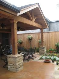 Concrete Patio Covering Ideas Gable Roof With Arched Chevron Ledgestone Bases Tongue And