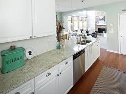 white kitchen cabinets with green granite countertops mint and white kitchen with granite countertops hgtv