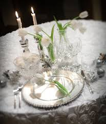 winter wonderland wedding with lots candlelight and high topiaries