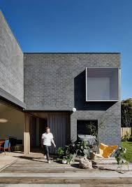 brick house this black brick house features generous spaces with a high degree