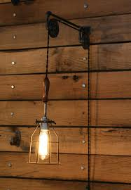 wall mounted pendant light pulley wall mount with industrial cage light and wooden handle