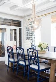 amazing dining room features a west elm large rectangle hanging