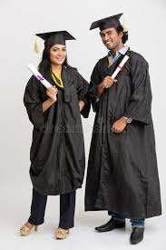 college graduation cap and gown happy indian college graduates wearing cap and gown holding