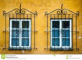 two windows with ornamental metal lattice stock image image