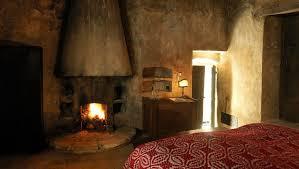rooms with terracotta floors in abruzzo sextantio