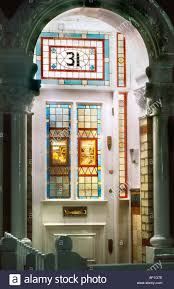 victorian stained glass front door at night british housing london