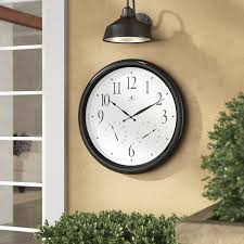 the 24 outdoor lighted atomic clock darby home co ernesha oversized 24 definitive wall clock reviews