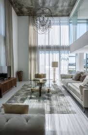 Living Room Table Accessories by Modern Living Room With Round Chandelier And Metallic Accessories