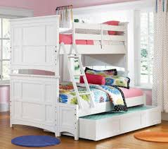 full over full bunk beds with stairs drawers before the white wall