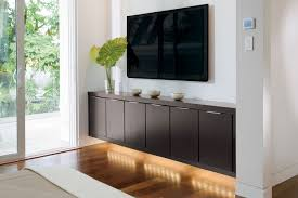 Living Room Media Furniture Brown Stain Wall Come With Brown Ceramics Floor Tile And Varnished