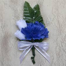 royal blue corsage blue carnation boutonniere