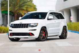 gray jeep grand cherokee with black rims custom jeep grand cherokee with red accents and vossen wheels