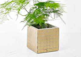 pot ustensile cuisine cache pot mozaic gold par serax dans le style cubique