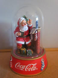 find more reduced coca cola santa in glass dome from