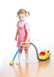 Toy Vaccum Cleaner Kid Playing And Cleaning Room With Toy Vacuum Cleaner Stock Photo