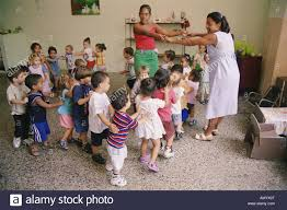 nursery children playing game in classroom cuba stock