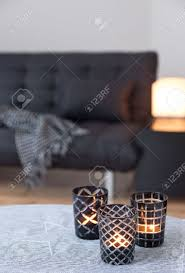 tea lights in glass candle holders decorating living room with