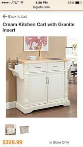 big lots kitchen cabinets cherry finish kitchen cart with marble top at big lots 299 99