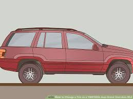 jeep grand change how to change a tire on a 1999 2004 jeep grand wj
