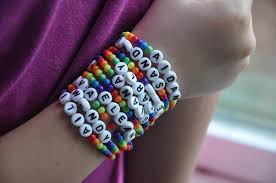 beaded bracelet name images Backless shirt rainbow party favor bags and bracelets JPG