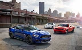 chevy camaro vs dodge charger our 25 tests reviews and comparos of the year feature