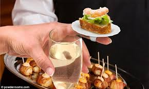 shoing canapé finger food literally mini ring plates that you can perch canapes