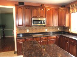 brown granite countertops with white cabinets dark cabinets white countertops kitchen with and black tile
