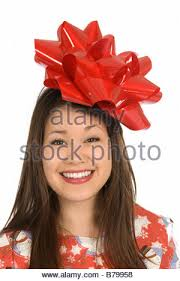 asian wrapping paper a asian woman smiles as she is wrapped in christmas wrapping