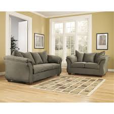 signature design by ashley darcy living room set in sage fabric at