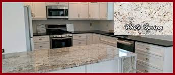 Kitchen Featuring Different Granite Countertops And Granite Island