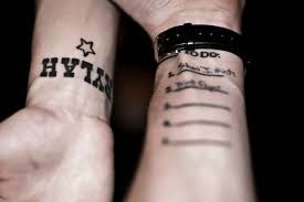 dvrg names on wrist tattoos