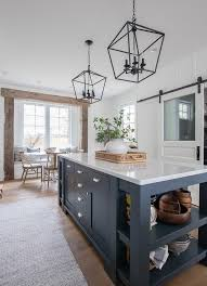 blue kitchen island and white cabinets navy island white kitchen the lilypad cottage