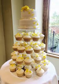 2 tier wedding cake with cupcakes gardners cakery budget wedding