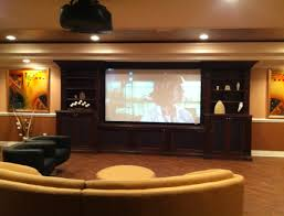living terrific home movie theater rooms with beige accent walls