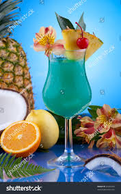blue hawaiian cocktail blue hawaiian cocktail surrounded by tropical stock photo 42479356
