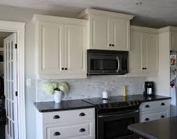 kitchen backsplash with dark granite and white cabinets