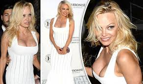 pamela anderson dangerously close to nip slip as she hits cannes