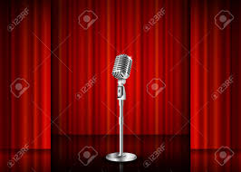 vintage metal microphone against red curtain backdrop mic on