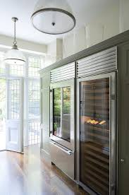 build your own refrigerated wine cabinet integrated wine fridge next to glass front fridge transitional