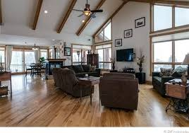 country living room with exposed beam hardwood floors in