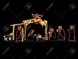 manger scene in beautiful colorful christmas lights stock photo