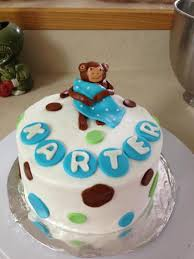 baby shower cake in monkey theme for a baby boy vanilla