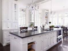 suzie sage design lovely kitchen with black glass front cabinet