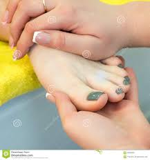 pedicure and foot massage woman in a beauty salon for pedicure and