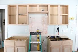 how to paint unfinished cabinets kitchen renovation unfinished oak cabinets
