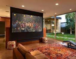 Drop Down Tv From Ceiling by Drop Down Screen Converts Tv Room To Theater Electronic House