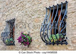 wrought iron security bars windows in pienza stock images