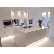 Contemporary Kitchen Decorating Ideas by Modern White Gloss Integrated Handle Kitchen With 18mm Corian Wrap