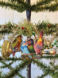 dresden ornaments four birds sitting on elaborately decorated